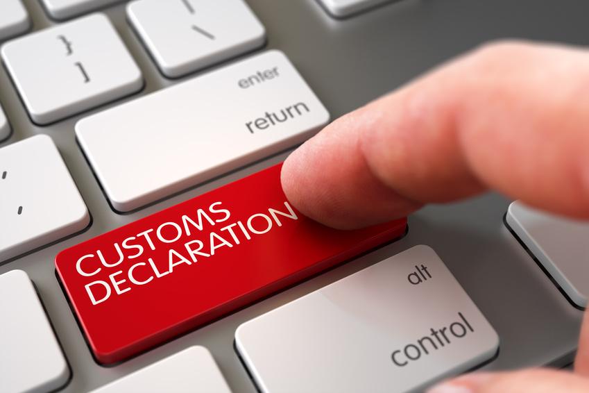 Man Finger Pushing Customs Declaration Red Keypad on Aluminum Keyboard. 3D Illustration.